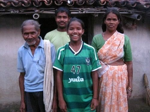 Shivani Toppo with her mothr Jhari Devi and grandfather Dukhan Pahan at their home in Hutup in Ormanjhi Ranchi'