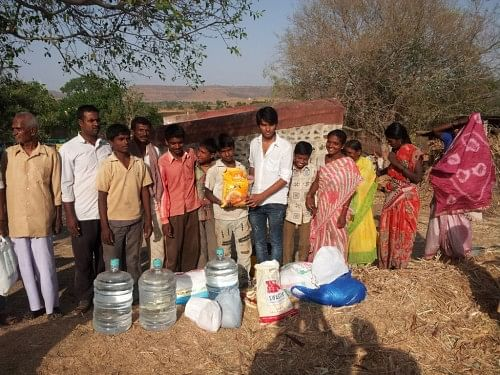 Food and water being distributed to the villagers in the drought-affected areas