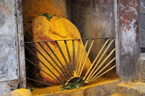 An idol covered with molten sun.