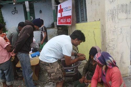 Dr Bhavin Kodiyatar conducting medical camp. In 4 days he examined 408 patients