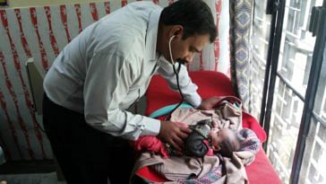 Dr Jayakumar Reddy treating a newborn child