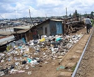 The poor hygienic condition in Nehrunagar slum, where people largely make money from sorting waste
