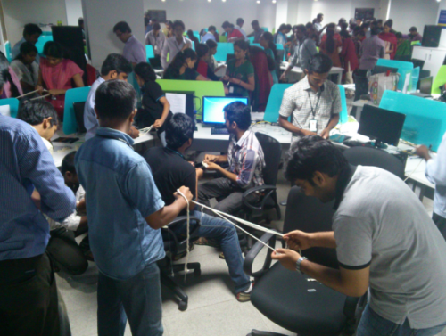 130 employees of RapidValue, an IT firm located at Infopark in Kochi volunteered and made 10,000 wicks