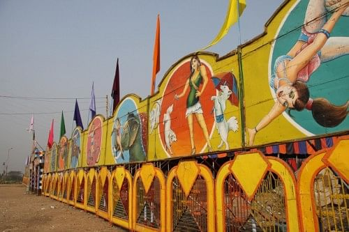 Hoardings done in Kitsch-style, announcing the goings-on inside the tent.