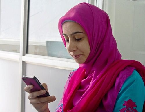 Mehvish Mushtaq's 'Dial Kashmir' phone app is a one-stop source for information on healthcare, education, transport, police and many other sectors. (Credit: Yawar Kabli\WFS)