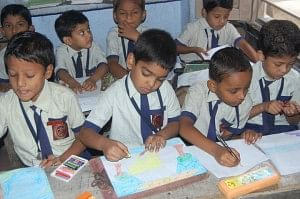 Children participating in an inter-school drawing competition at the school