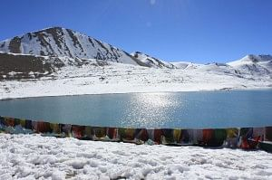 The pristine Lake Gurudongmar lined with prayer flags on one side