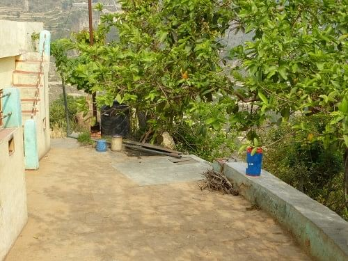 A simple rooftop rainwater harvesting system in Duarab. Here the tank forms part of the yard