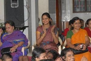 Dr. Vasudha Prakash (centre) enjoying the concert with the children