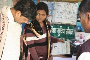 INDUS ACTION's Helpdesk Manager at Sangam Vihar answering a parent's query.
