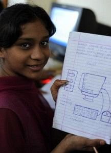 A rescued girl learning computer education with this NGO's help