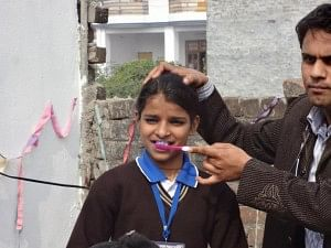 Basic tenets of personal health and hygiene are taught to the students from low income families