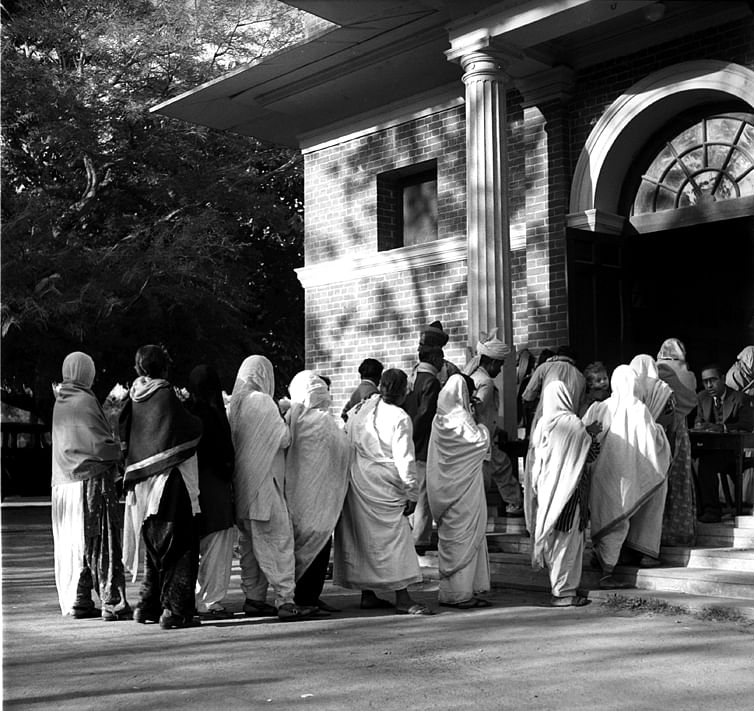 A view of Polling Booth at Modern High School, in New Delhi. A long queue of women voters are seen waiting for their turn to cast their votes.
