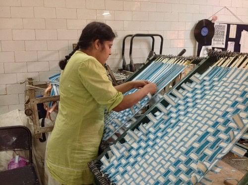 Weaving mats at the Society