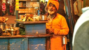 Waiting for freebies at a roadside stall.