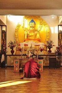Praying at Shanti Stupa.