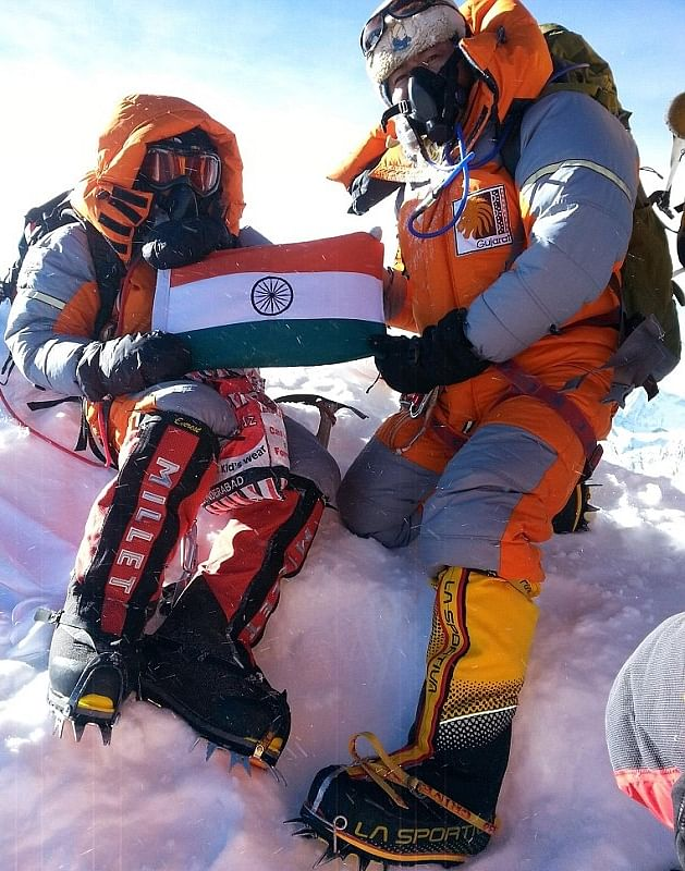 To commemorate their feat, Malavath (left), along with her fellow climber Anand, left a photo of Dr. Ambedkar and the Indian flag at the peak.