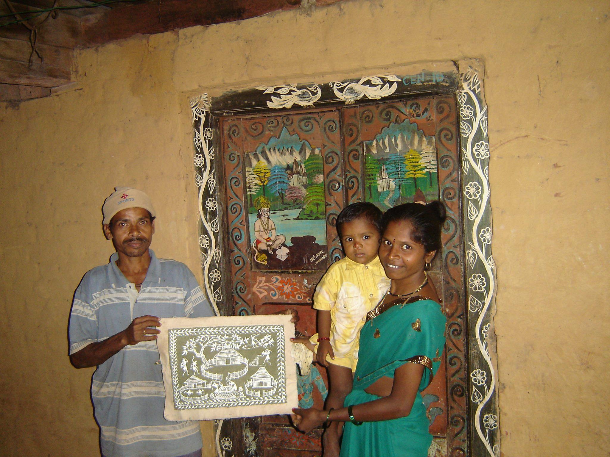 Warli artist Sadanand and his wife.
