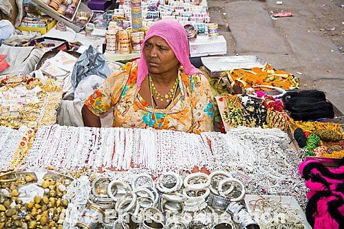 woman selling inexpensive jewellery in sardar market, jodhpur, rajasthan, india