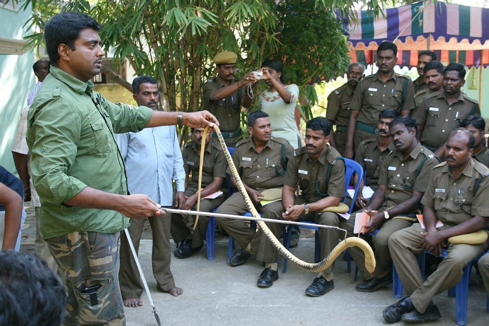 Vanamitra gives training to security guards to rescue snakes safely.