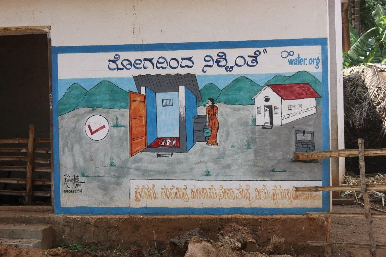 The poster translates to 'freedom from diseases' showing the positive effect of adopting safe sanitation practices.
