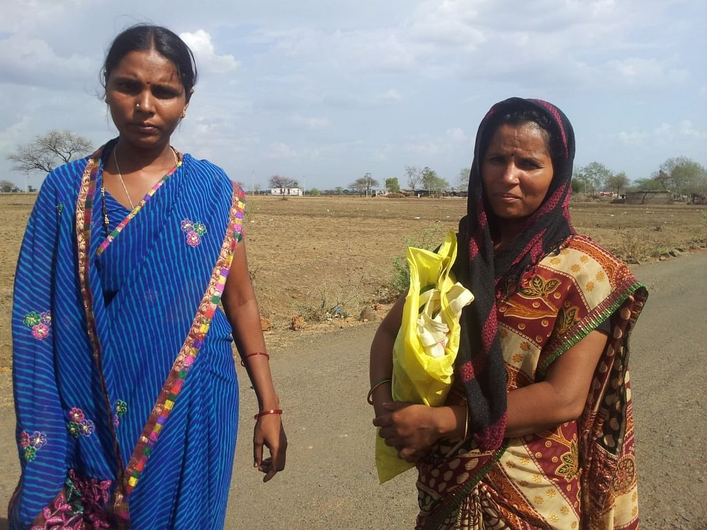 Yogita, 28, and Ashalatha, 32, are aware of their basic rights and social entitlements and talk about the various welfare policies of the government with other community members. (Credit: Pushpa Achanta\WFS)