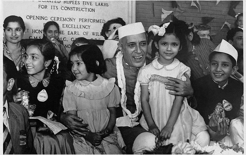 Jawaharlal Nehru sharing a light moment with kids.