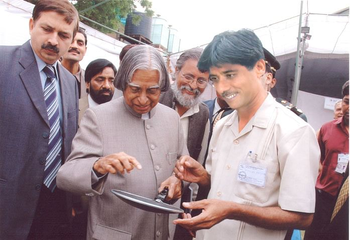 Mansukhbhai (right) with former president Dr. APJ Abdul Kalam.