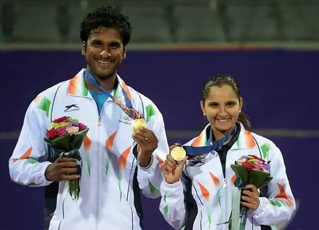 Gold medallist India's Sania Mirza (R) with Saketh Sai Myneni at the medal ceremony.