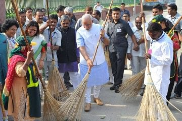 Prime Minister Narendra Modi (Center) kick started Swachh Bharat Abhiyan on October 2.