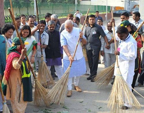 Prime Minister Narendra Modi (Center) kick started Swachh Bharat Abhiyan on October 2.