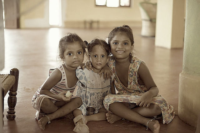The girl in the middle is very clever except that she has multiple deformities. From a cleft lip and palate to a single arm and deformity in her legs; in the company of normal kids she has learnt how to use her disabilities to her advantage and thus enjoys the status of being everybody's pet.