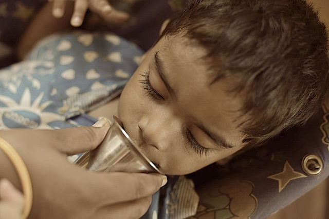 This boy is not only paralysed in his legs, he also has pain if he closes his jaw. Simple tasks like drinking water become a trial for those who feed. Half the water goes trickling down the sides of the mouth.