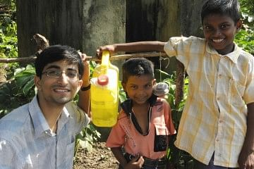 Pawan and kids with Nirman, a low-cost hand washing device.