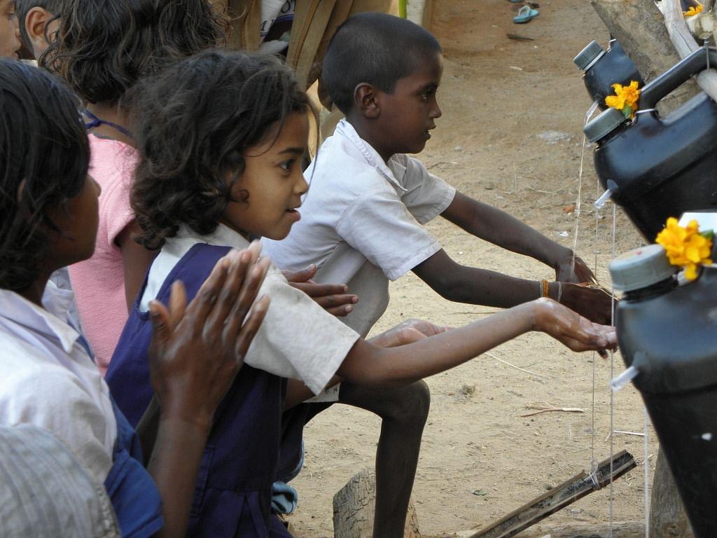 Children wash their hands clean with Nirman