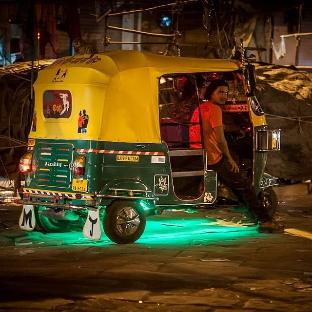 The auto rickshaw guy in India work day and night to make his ends meet.