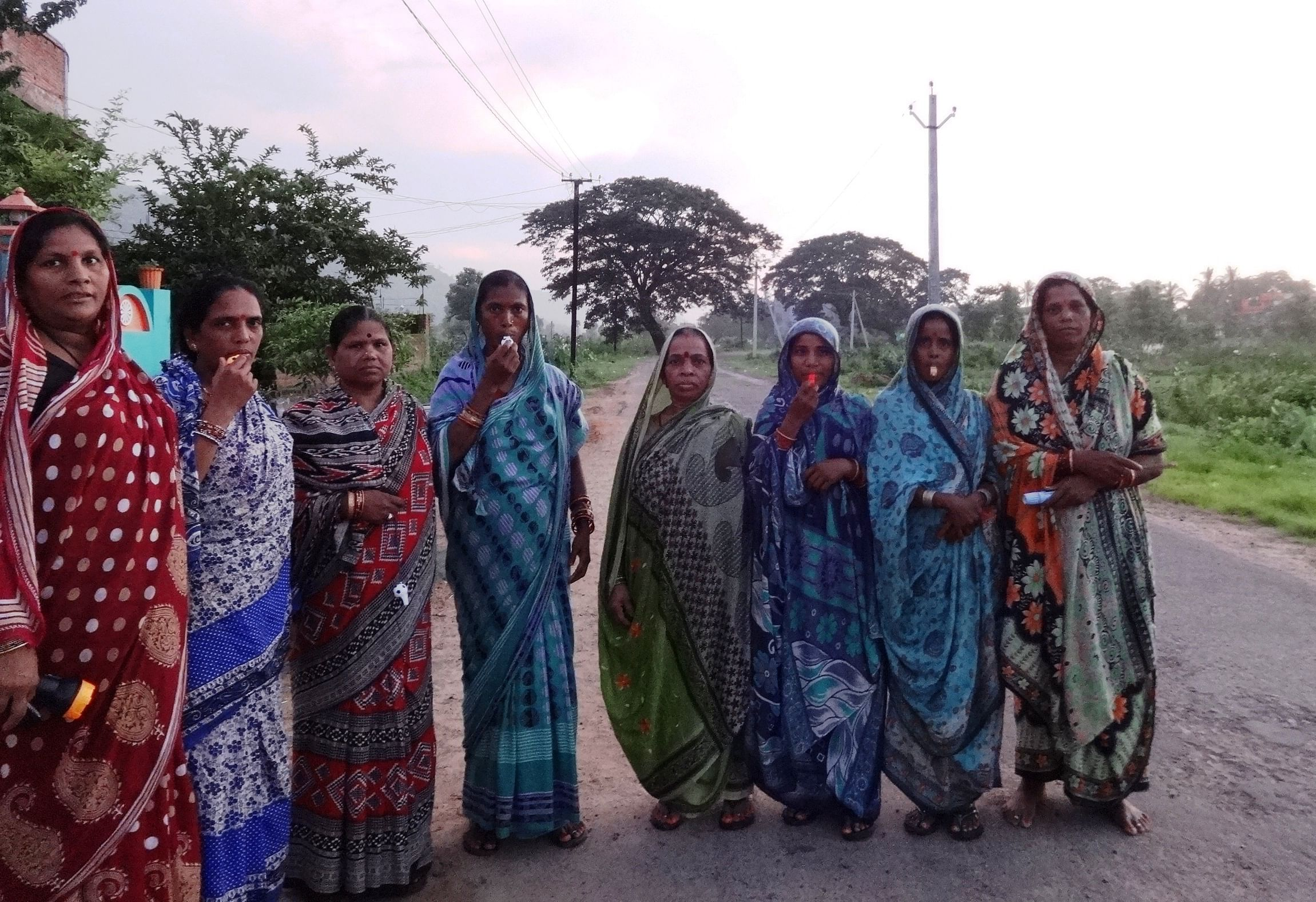 Twice a day, the Whistle Bahinis patrol the main road that leads their villages to the Jagannath Prasad block headquarters to prevent people from open defecation. (Rakhi Ghosh\WFS)