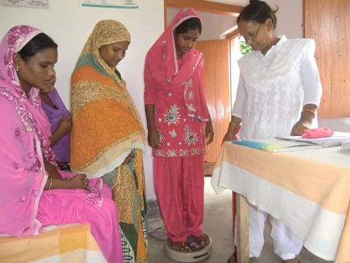 Women in Marwatoli village in Bihar's Kishanganj district undergo weight checkup at the Health Sub Centre under supervision of Auxillary Nurse Midwife. (Credit: Ajitha Menon\WFS)