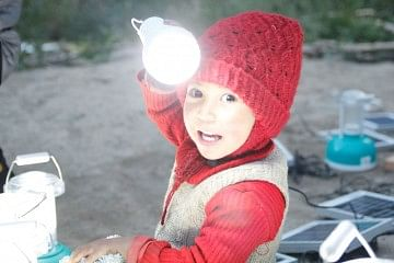 child with solar bulb