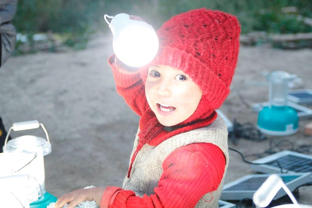 child with solar bulb