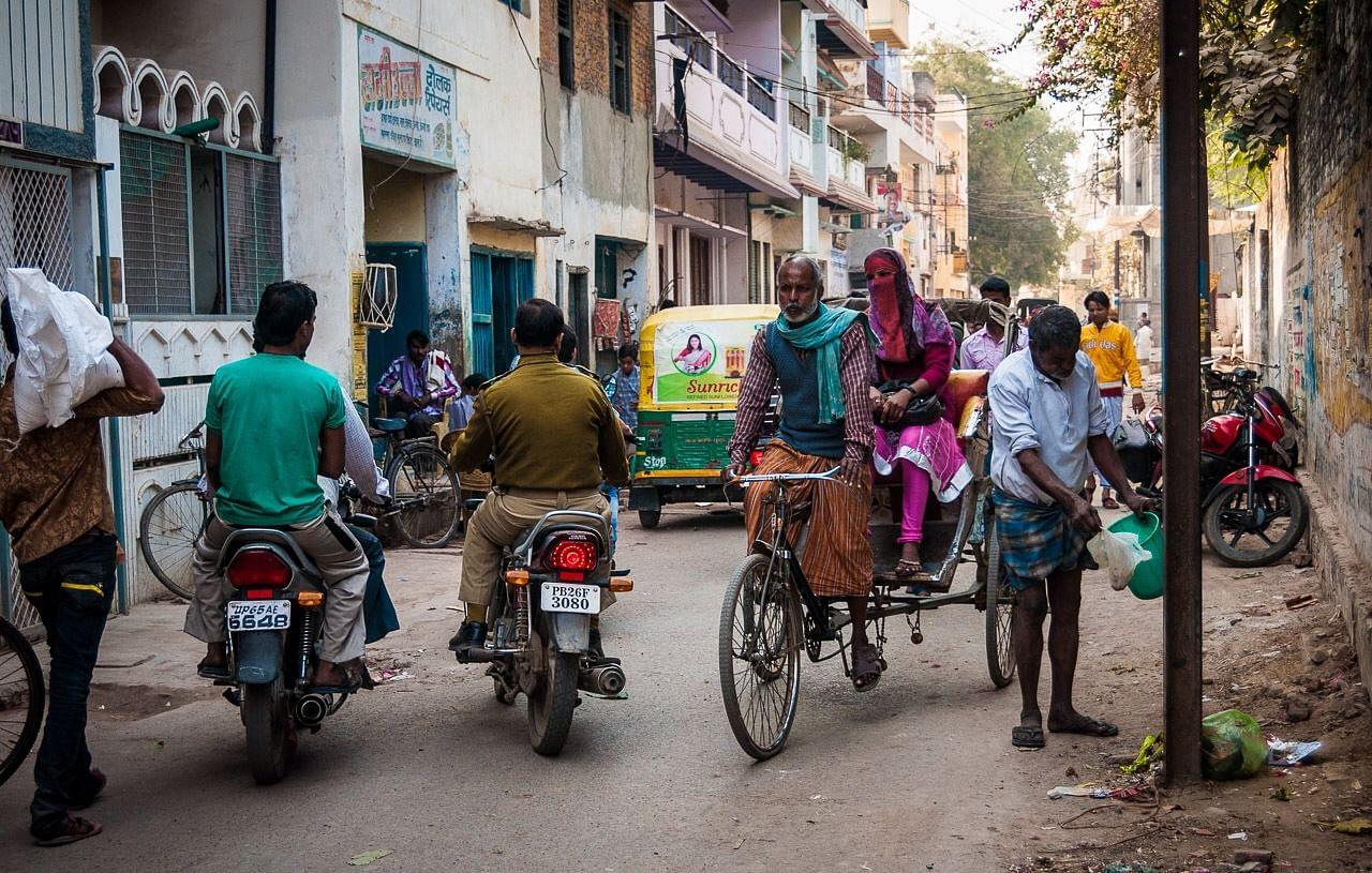 The cycle rickshaws.