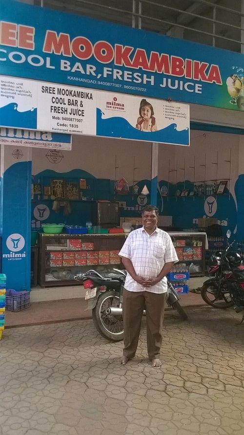 Sudhakaran outside his shop.