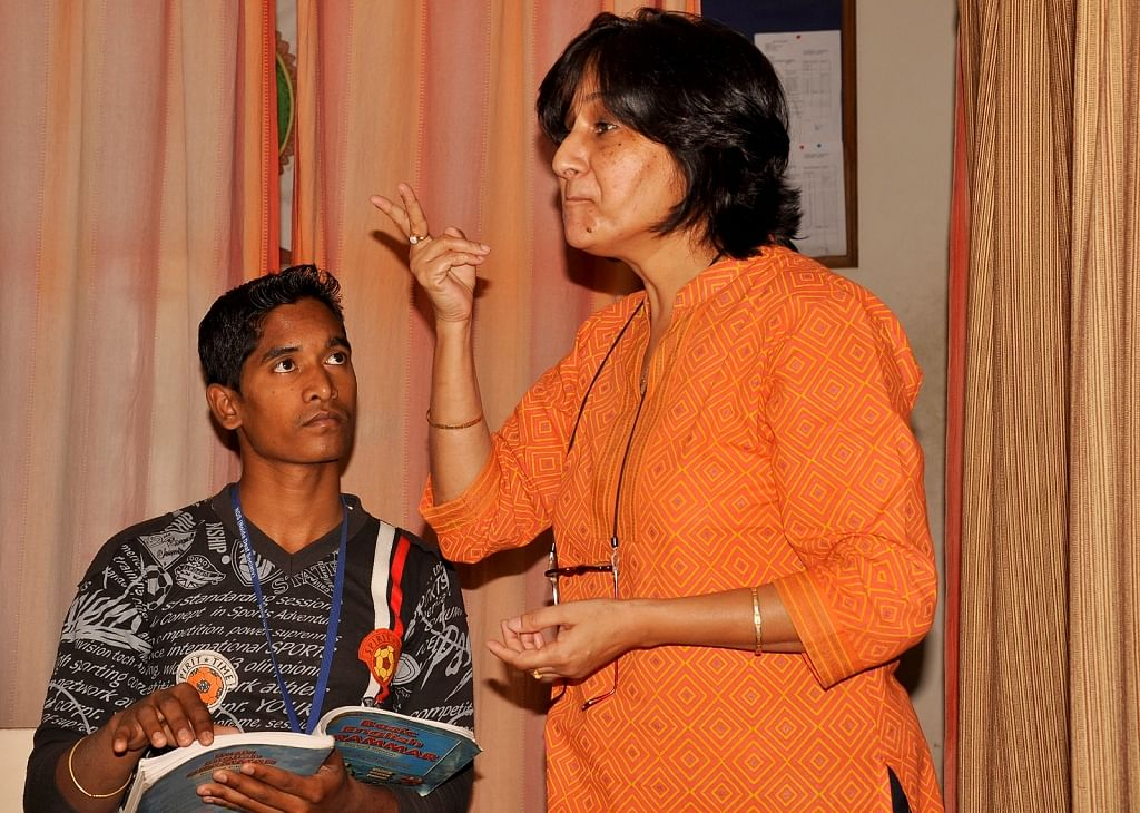 Teacher of Noida Deaf Society during the class.
