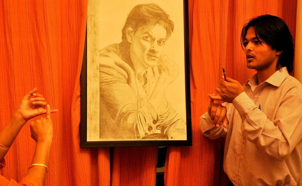 Students of Noida Deaf Society with his art work of Bollywood Actor, Shahruh Khan.
