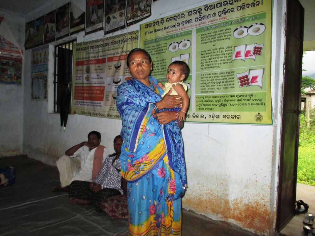 Binita Kanhara, 32, a tribal woman from Rajkhol village, in Kandhamal district of Odisha, is a happy mother of two healthy children today. She owes her well-being and that of her children to ASHA worker Martha Diggal. (Credit: Sarada Lahangir\WFS)