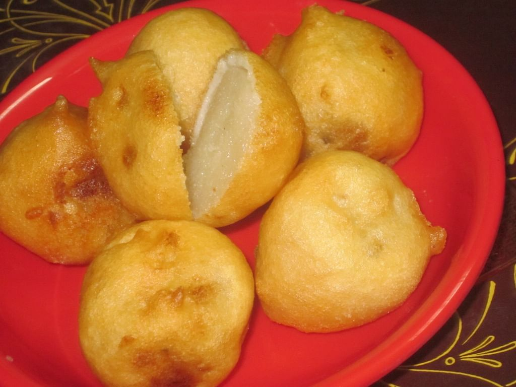 Golden Poornalus are a popular Andhra festive sweet made with rice flour and jaggery.