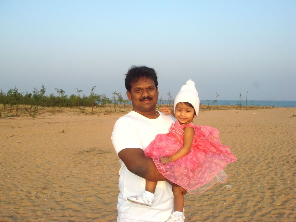 Kishore with his daughter.