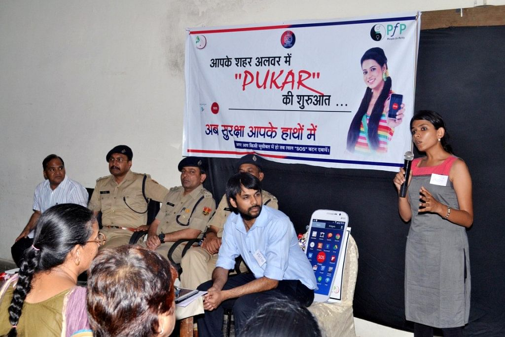 Arushi explaining how Pukar works and why it will be effective to use in emergencies to an audience of social sector leaders, press and police personnel at the launch of Pukar in Alwar.