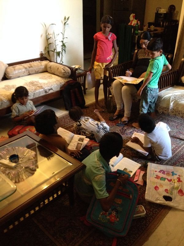 Every day after school hours, the students gather in Ritu's living room for an interactive learning session.