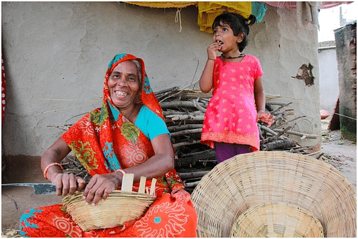 Sharada from Bhabra, MP, weaves baskets to put her grandchild through school.